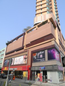 Photo 5: A new building with street shops occupied by chain stores.